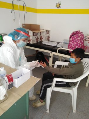 Figure 2-Screening test to one of the kids.