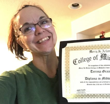 A proud graduate who is now a CPM Midwife!
