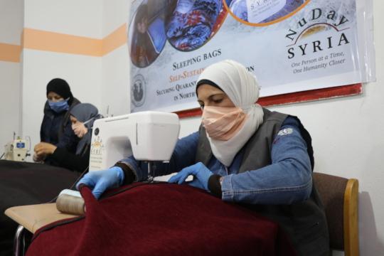 Woman sewing a sleeping bag
