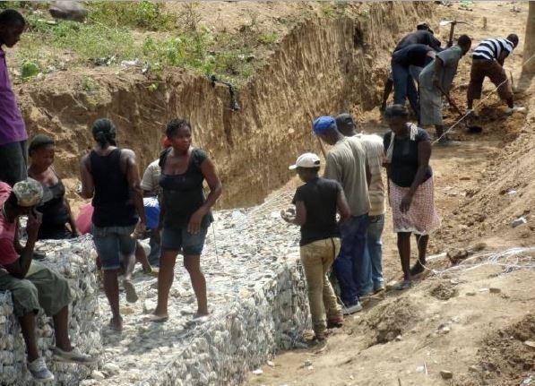 Building flood walls near Trou-du-Nord
