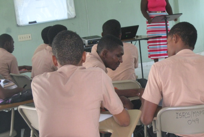 Genel working with a classmate