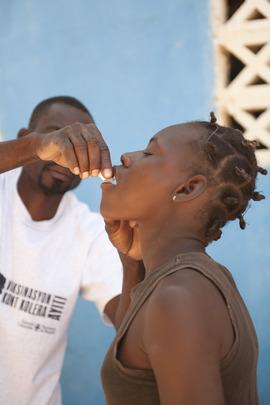 Patient receiving Cholera treatment from PIH