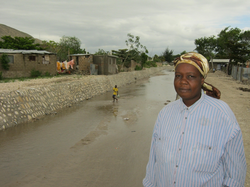 Camelita Cadet with the canal that saved her home