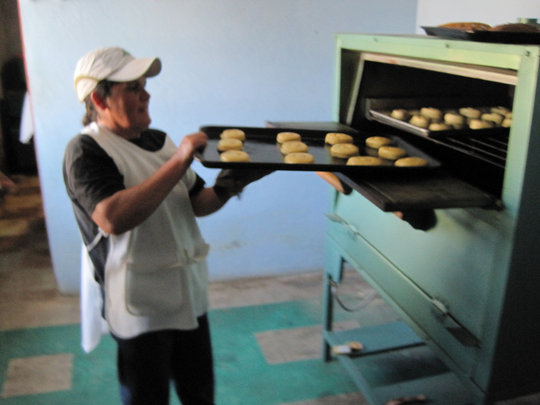A woman works at her community bank´s business