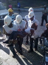 Red Cross workers bringing a patient to Hinche Hospital
