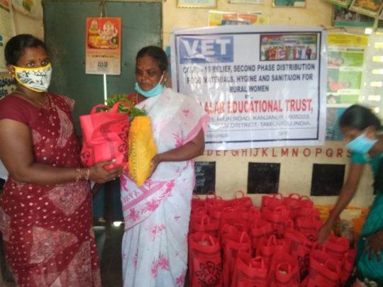 women receiving dry ration materials