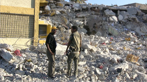 Journalists in front of the destroyed Radio Magic 9