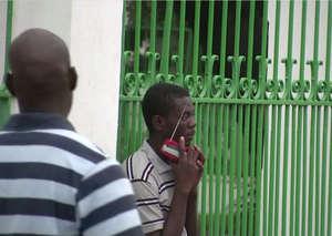 Listening to a portable radio, Port-au-Prince