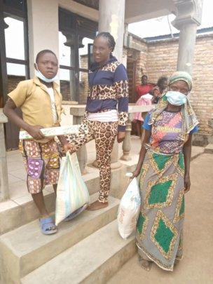 John's mother receiving food