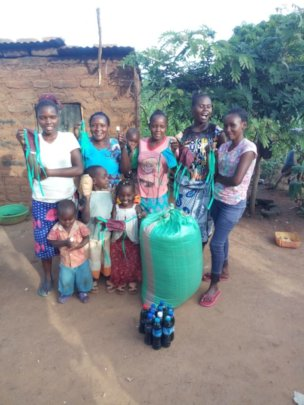 Faith and her family with emergency supplies