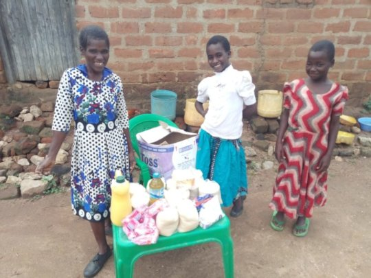 Josephine and her family with their supplies
