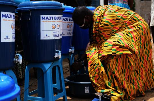 Community chief demonstrates handwashing