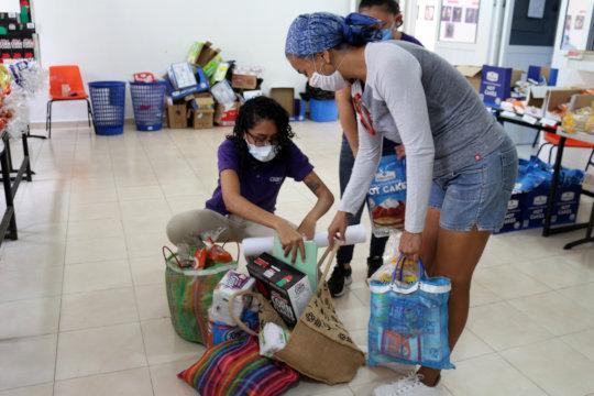 CIAM team members pack up food and sanitation kits