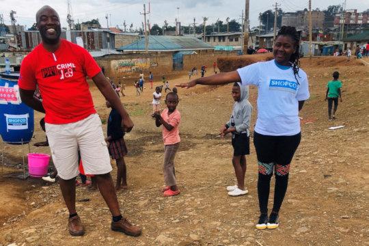 Community leaders model social distancing