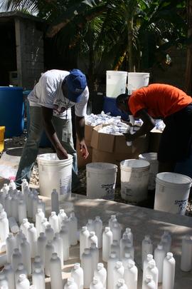 DSI staff prepare bottled chlorine