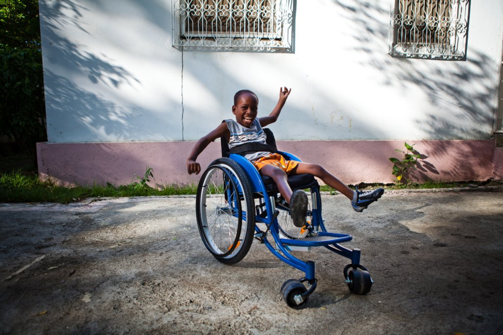 Child in adapted wheelchair