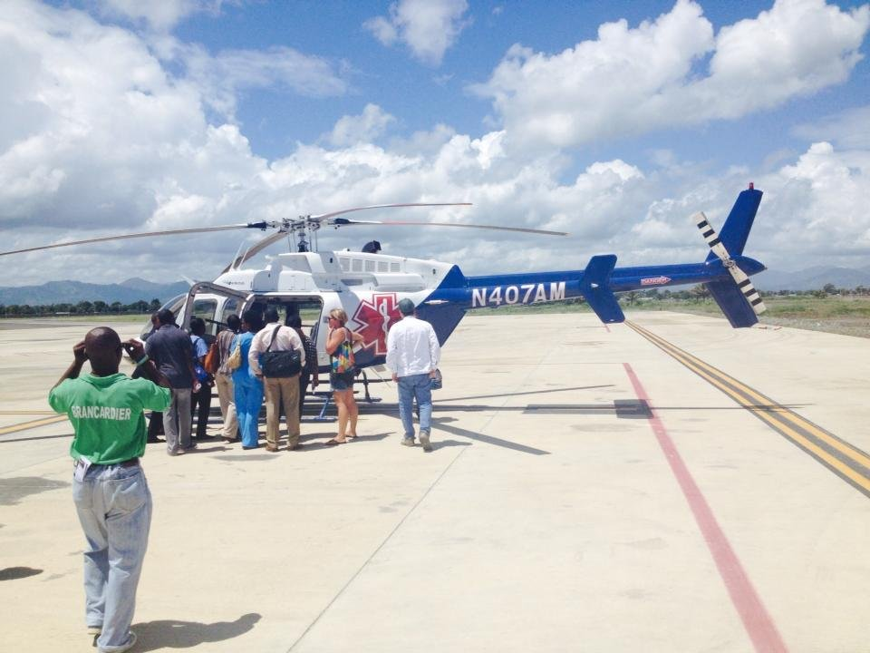 Staff seeing the new helicopter for Haiti