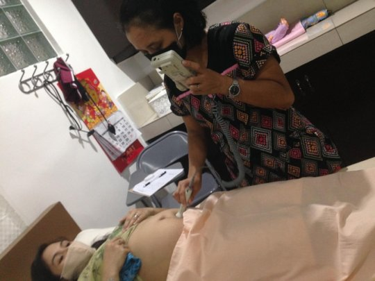 A Mercy In Action Midwife caring for Mother & Baby