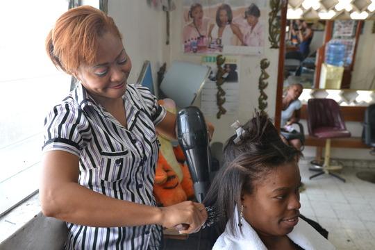 Bilha working with a customer in Haiti