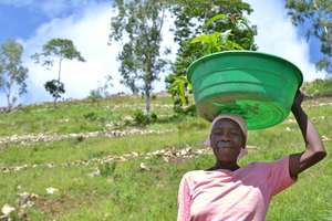 Woman with her plantings to reduce soil erosion