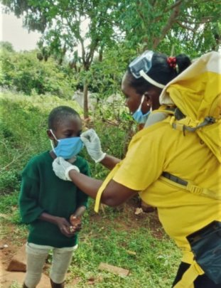 CHAT CORP helping a child put on a mask