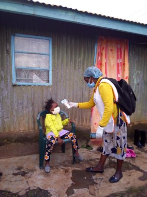 Lucy doing C19 screening door to door in the slum