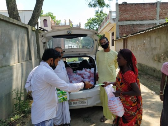 Distribution of Sanitization material and Grains