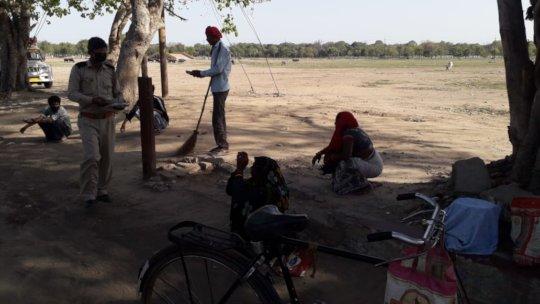 Distributing Food to Street Workers