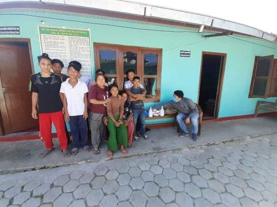 Distributing masks, hand sanitizer and medicines