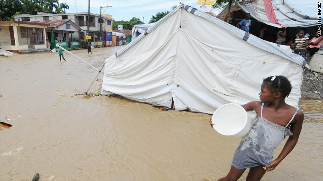 Rain from Hurricane Tomas floods a tent in Haiti