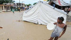 Rain from Hurricane Tomas floods a tent in Haiti