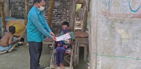 Rajan Received Awareness raising Leaflet on COVID