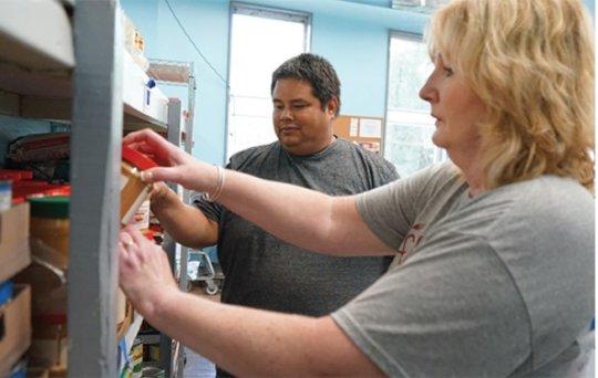 As well as receiving, Pedro volunteers at Damien's