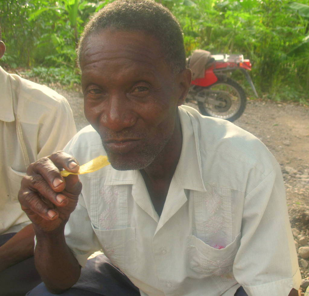 Member eating plantain chips made at the CPP