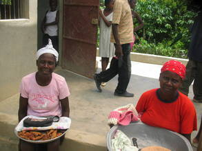 Women selling goods at a local grain mill