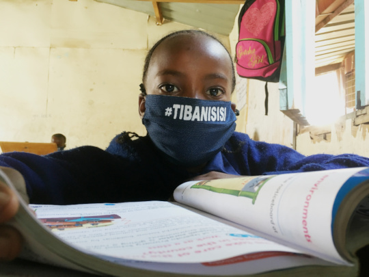 Grade 4 student in donated mask ready to learn!