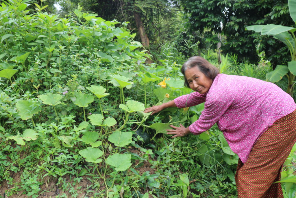 One of the women we are supporting with seeds