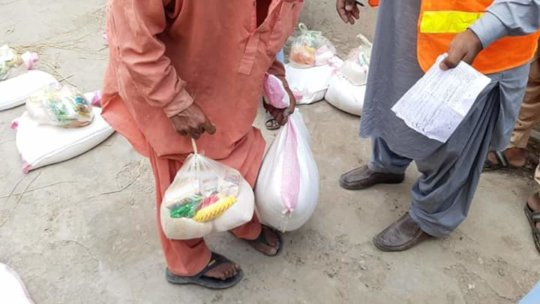 An Old Man receiving Ration Package