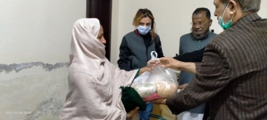 Ration being Distributed to a Poor Women