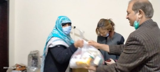 A Needy Women Receiving Ration