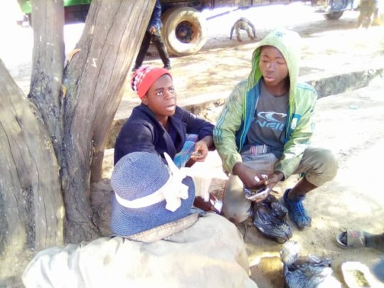 Chatting with street boys during Kimbilio outreach