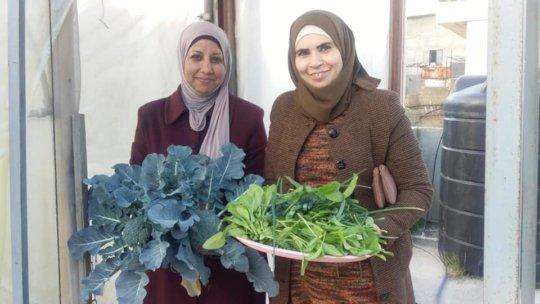 Women showing off their winter harvest