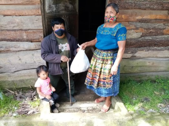 Man with disability receiving pantry supplies