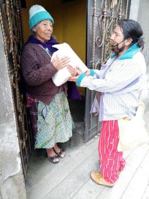 Elderly woman receiving pantry supplies