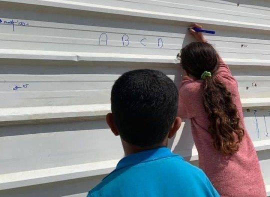 Schoolchildren in Naqab. Photo: Amir Abu Kaf