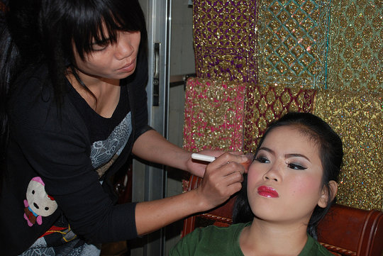 Channa (left) practices makeup application
