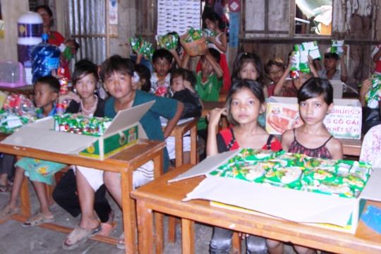 Children attending a literacy class in Trolok Baik