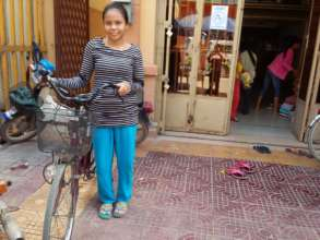 Muon with her bike provided by LO