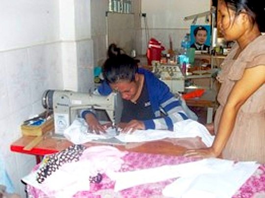 Tieng Sophy, hard at work, learning tailoring!