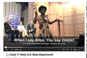 Cleopatra (Zimbabwe) leads State Department rally.